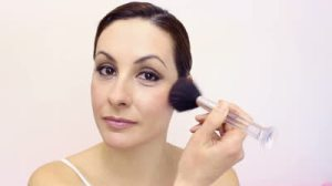 stock-footage-a-beautiful-young-woman-applied-blush-on-her-face-make-up-video-clip